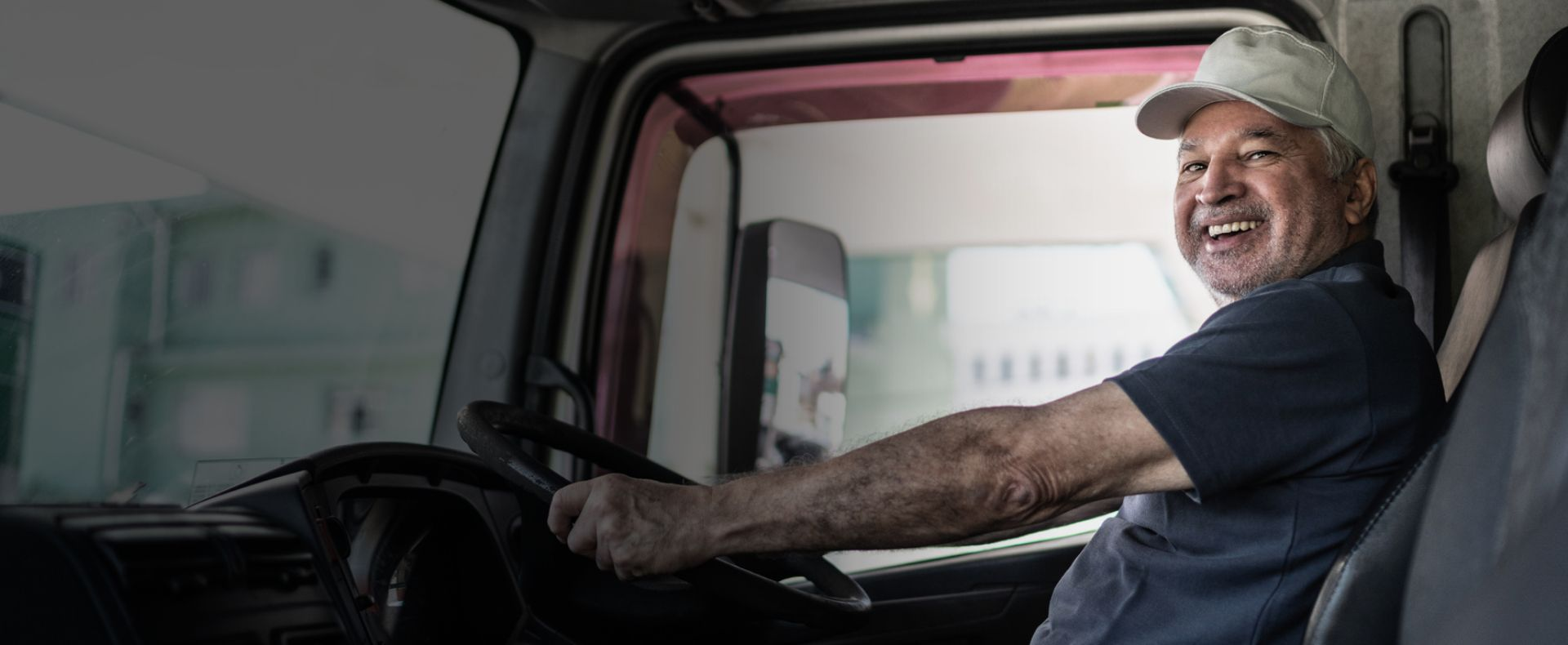 Man sitting behind wheel of truck, commercial driver