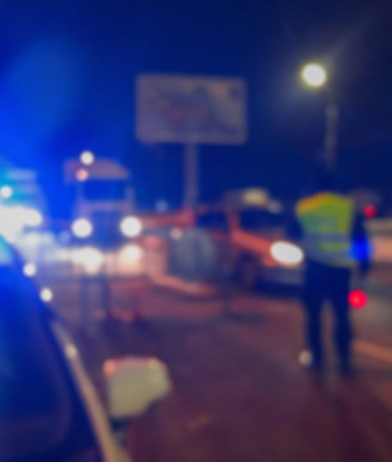 Police lights on side of road, photo out of focus